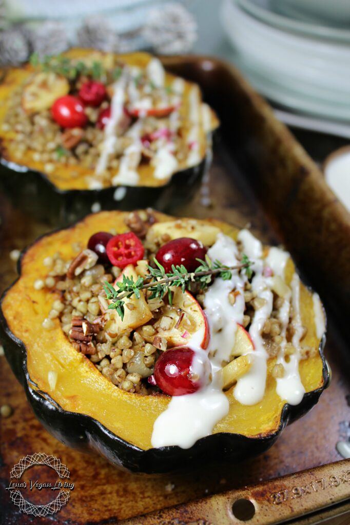 Stuffed Acorn Squash with Buckwheat, Cranberries, Apples & Pecans, Drizzled with Creamy Dressing.